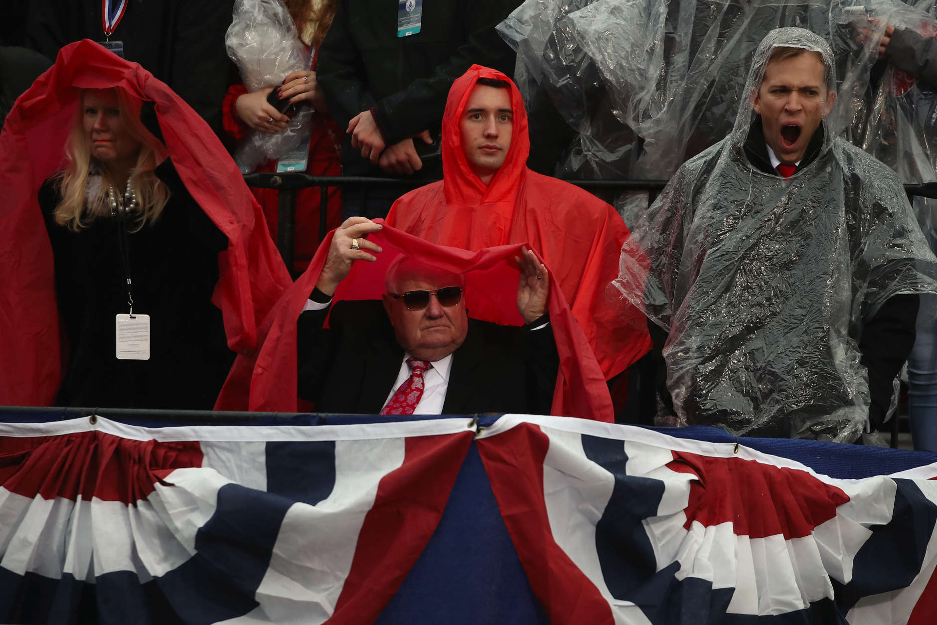 WASHINGTON, DC - JANUARY 20:  Spectators line the parade route in the rain during the Inaugural Parade on January 20, 2017 in Washington, DC. Donald J. Trump was sworn in today as the 45th president of the United States.  (Photo by Mark Wilson/Getty Images)