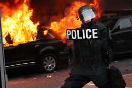WASHINGTON, DC - JANUARY 20:  Police and demonstrators clash in downtown Washington after a limo was set on fire following the inauguration of President Donald Trump on January 20, 2017 in Washington, DC. Washington and the entire world have watched the transfer of the United States presidency from Barack Obama to Donald Trump, the 45th president.  (Photo by Spencer Platt/Getty Images)