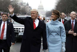 WASHINGTON, DC - JANUARY 20:  U.S. President Donald Trump waves to supporters as he walks the parade route with first lady Melania Trump after being sworn in at the 58th Presidential Inauguration January 20, 2017 in Washington, D.C. Donald J. Trump was sworn in today as the 45th president of the United States  (Photo by Evan Vucci - Pool/Getty Images)