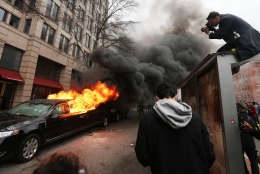 WASHINGTON, DC - JANUARY 20:  A limousine burns after being smashed by anti-Trump protesters on K Street on January 20, 2017 in Washington, DC. While protests were mostly peaceful, some turned violent. President-elect Donald Trump was sworn-in as the 45th U.S. President today.  (Photo by Mario Tama/Getty Images)