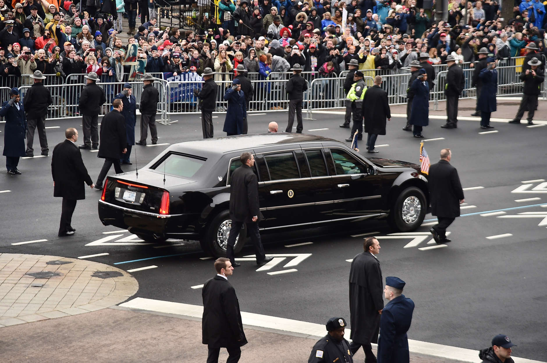 WASHINGTON, DC - JANUARY 20:  The presidential limousine carrying U.S. President Donald Trump and first lady Melania Trump turns onto Pennsylvania Avenue during the Presidential Inaugural Parade on January 20, 2017 in Washington, DC.  (Photo by Mike Coppola/Getty Images)