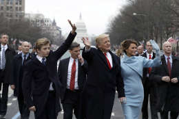 WASHINGTON, DC - JANUARY 20:  U.S. President Donald Trump waves to supporters as he walks the parade route with first lady Melania Trump and son Barron Trump after being sworn in at the 58th Presidential Inauguration January 20, 2017 in Washington, D.C. Donald J. Trump was sworn in today as the 45th president of the United States  (Photo by Evan Vucci - Pool/Getty Images)