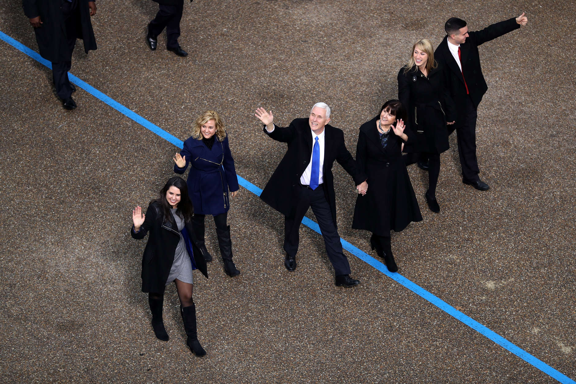 WASHINGTON, DC - JANUARY 20:  U.S. Vice President Mike Pence (3L) waves to supporters as he walks the parade route with his wife Karen Pence (3R) and their daughters Audrey Pence (L) and Charlotte Pence (2L) and son Michael Pence (R) during the Inaugural Parade on January 20, 2017 in Washington, DC. Donald J. Trump was sworn in today as the 45th president of the United States.  (Photo by Joe Raedle/Getty Images)