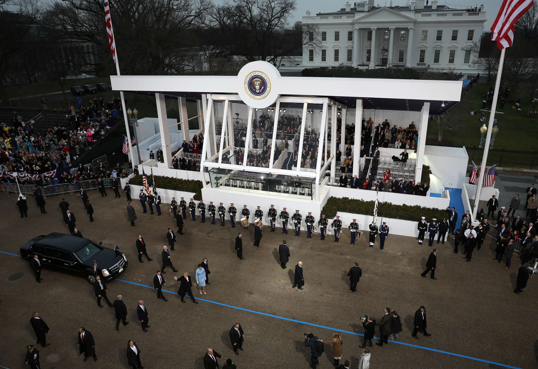 WASHINGTON, DC - JANUARY 20:  U.S. President Donald Trump waves to supporters as he walks the parade route with first lady Melania Trump and son Barron Trump past the main reviewing stand in front of the White House during the Inaugural Parade on January 20, 2017 in Washington, DC. Donald J. Trump was sworn in today as the 45th president of the United States.  (Photo by Joe Raedle/Getty Images)