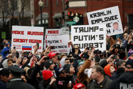 Protesters hold up signs during the Inaugural Parade on January 20, 2017 in Washington, DC. (Photo by Drew Angerer/Getty Images)