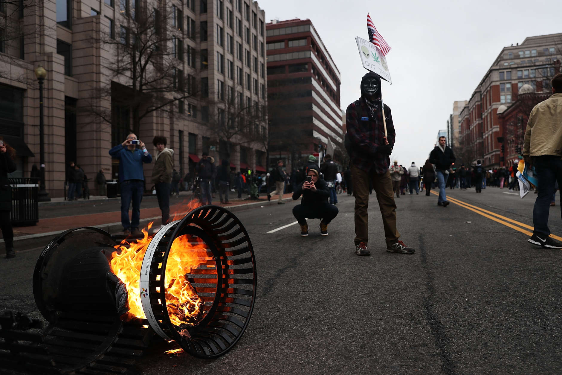 WASHINGTON, DC - JANUARY 20:  Police and demonstrators clash in downtown Washington D.C. following the inauguration of President Donald J. Trump on January 20, 2017 in Washington, DC. Washington and the entire world have watched the transfer of the United States presidency from Barack Obama to Donald Trump, the 45th president.  (Photo by Spencer Platt/Getty Images)