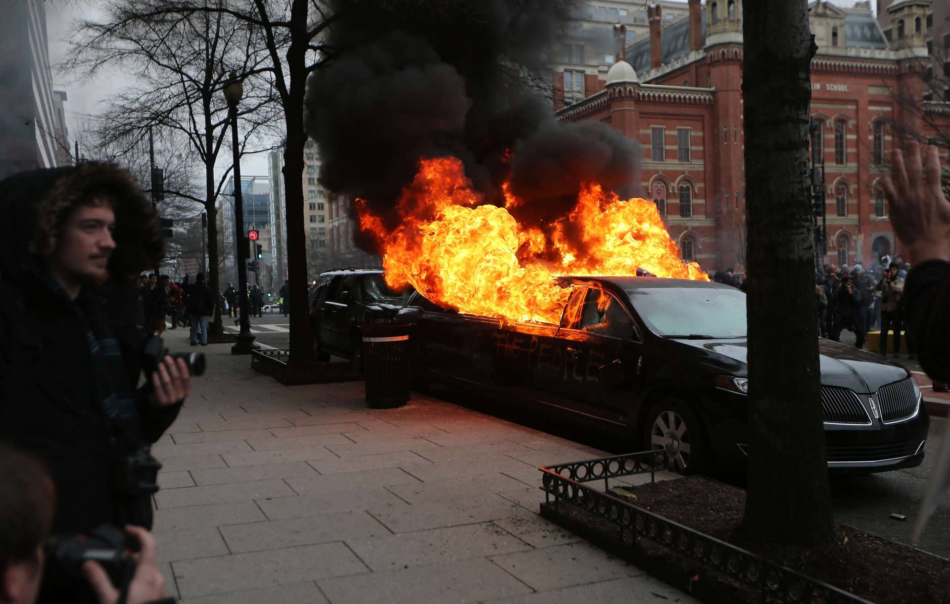 WASHINGTON, DC - JANUARY 20:  A limousine burns after being destroyed by anti-Trump protesters on K Street on January 20, 2017 in Washington, DC. While protests were mostly peaceful, some turned violent. President-elect Donald Trump was sworn-in as the 45th U.S. President today.  (Photo by Mario Tama/Getty Images)