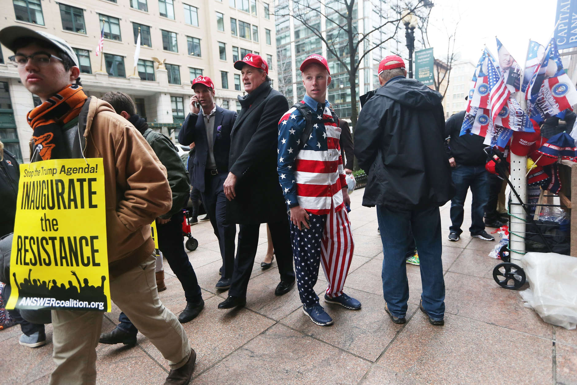 WASHINGTON, DC - JANUARY 20:  An anti-Trump protester (L) walks past Trump supporters on January 20, 2017 in Washington, DC.  President-elect Donald Trump was sworn in as the 45th U.S. President today.  (Photo by Mario Tama/Getty Images)