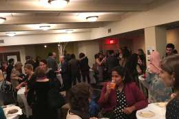 A packed downstairs social hall at Tuesday night's Refugee Ball, an event to show solidarity with members of refugee and immigrant communities and to educate the public about their contributions  to society. (WTOP/Liz Anderson)
