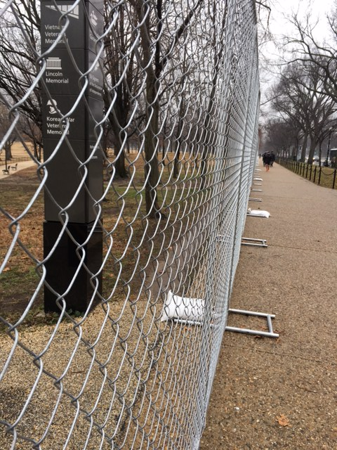 Fencing, like this seen near 19th Street and Constitution Avenue in D.C. on Saturday, Jan. 14, 2017, has begun to appear in areas around the National Mall in advance of Inauguration Day. (WTOP/Jenny Glick)