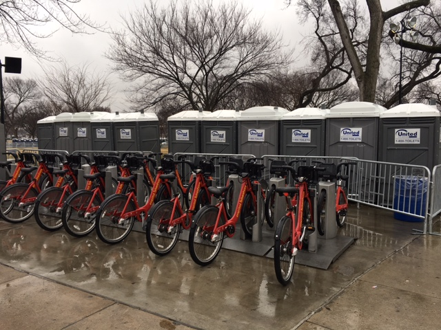A line of portable toilets has appeared behind a Capital BikeShare station near the National Mall on Saturday, Jan. 14, 2017, in advance of Inauguration Day. (WTOP/Jenny Glick)