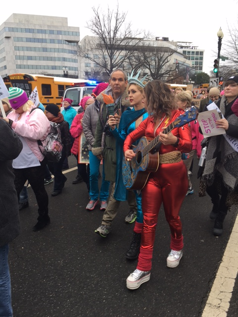 People in costumes make their way toward the National Mall for the Women's March on Washington in D.C. on Saturday, Jan. 21, 2017. (WTOP/Jenny Glick)