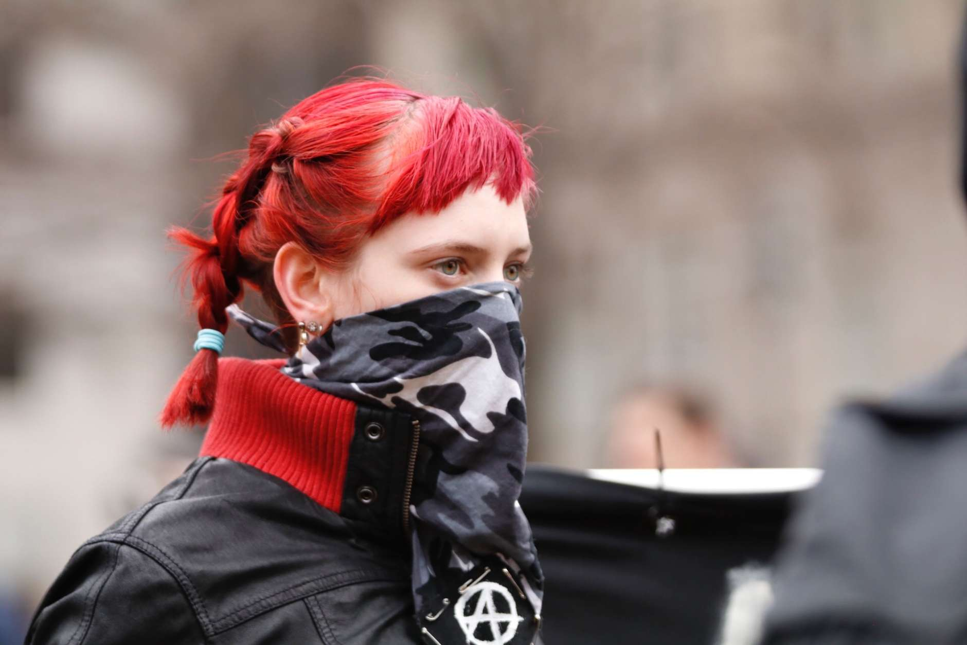Participant at an anti-Trump rally in McPherson Square on Friday, Jan. 20, 2017. (WTOP/Kate Ryan)