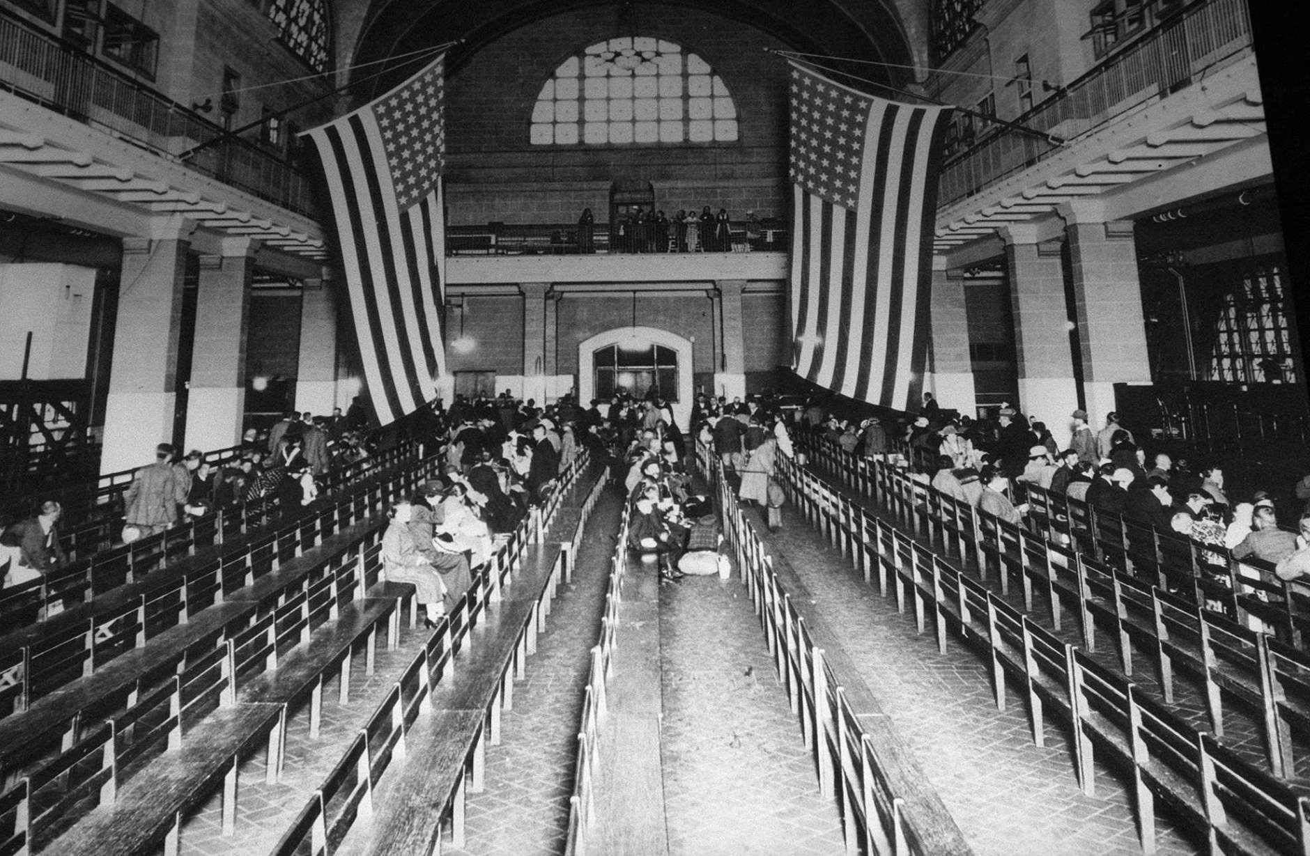 FILE--In this is a 1924 file photo, the registry room at Ellis Island in New York harbor. Immigration to the U.S has come in swells and dips over the past two-plus centuries, driven by shifts in U.S. policy, the mood in the country and world events. Labor shortages, racial tension, economic forces, religious prejudice and national security concerns all fit into the picture. (AP Photo/file)