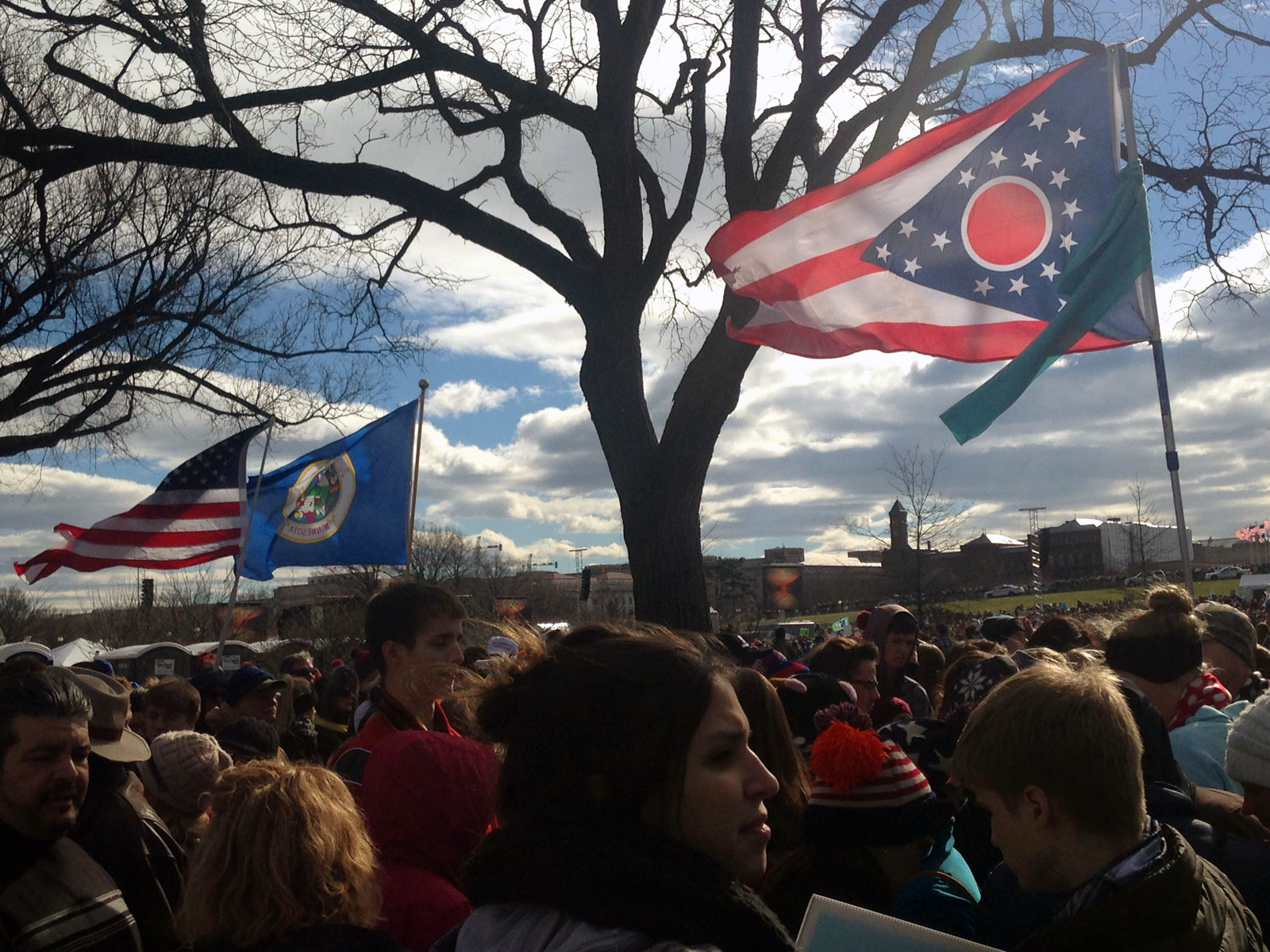 The state flags of Pennsylvania and Ohio flap in the wind at the March for Life on the National Mall on Friday, Jan. 27, 2017. (WTOP/Megan Cloherty)