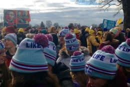 """A group of people wearing """"Like Life"""" hats attend the annual March for Life on the National Mall on Friday, Jan. 27, 2017. (WTOP/Megan Cloherty)"""