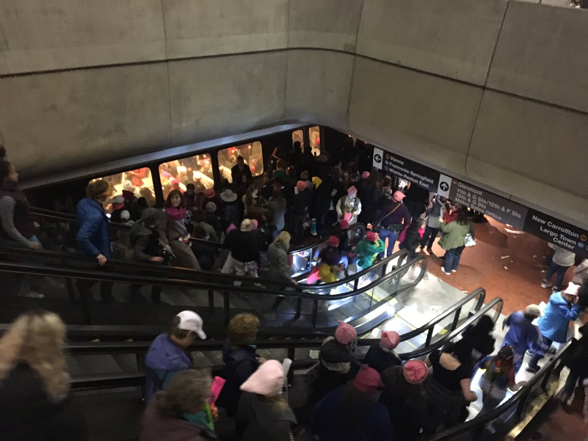 Large crowds from the Women's March on Washington pack the platform for Blue, Orange and Silver Line trains at Metro Center on Saturday, Jan. 21, 2017. (WTOP/Max Smith)