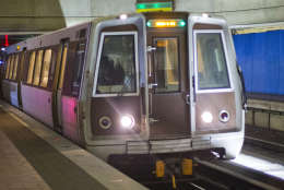A subway train arrives at the L'Enfant Metro Station, which is part of the public mass transit network for Washington, Tuesday, Jan. 13, 2015. (AP Photo/Pablo Martinez Monsivais)