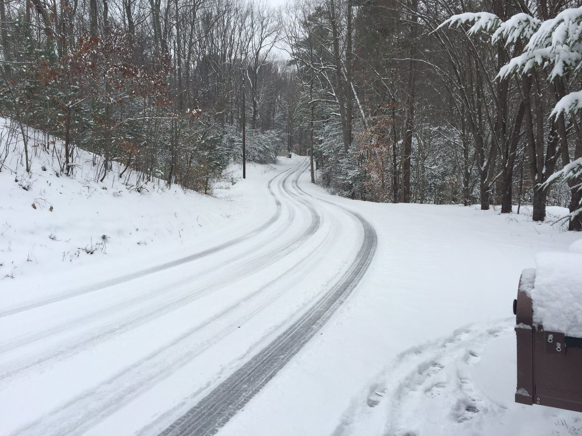 Snow covers a winding, wintry road Saturday in Calvert County, Md. (WTOP/Michelle Basch)