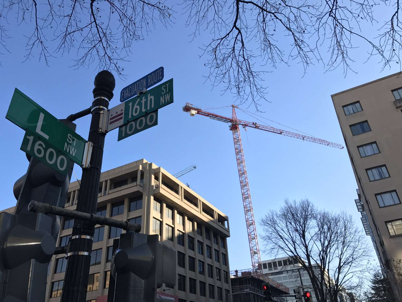 Protesters on a crane in downtown D.C. Wednesday. (WTOP/Neal Augenstein)