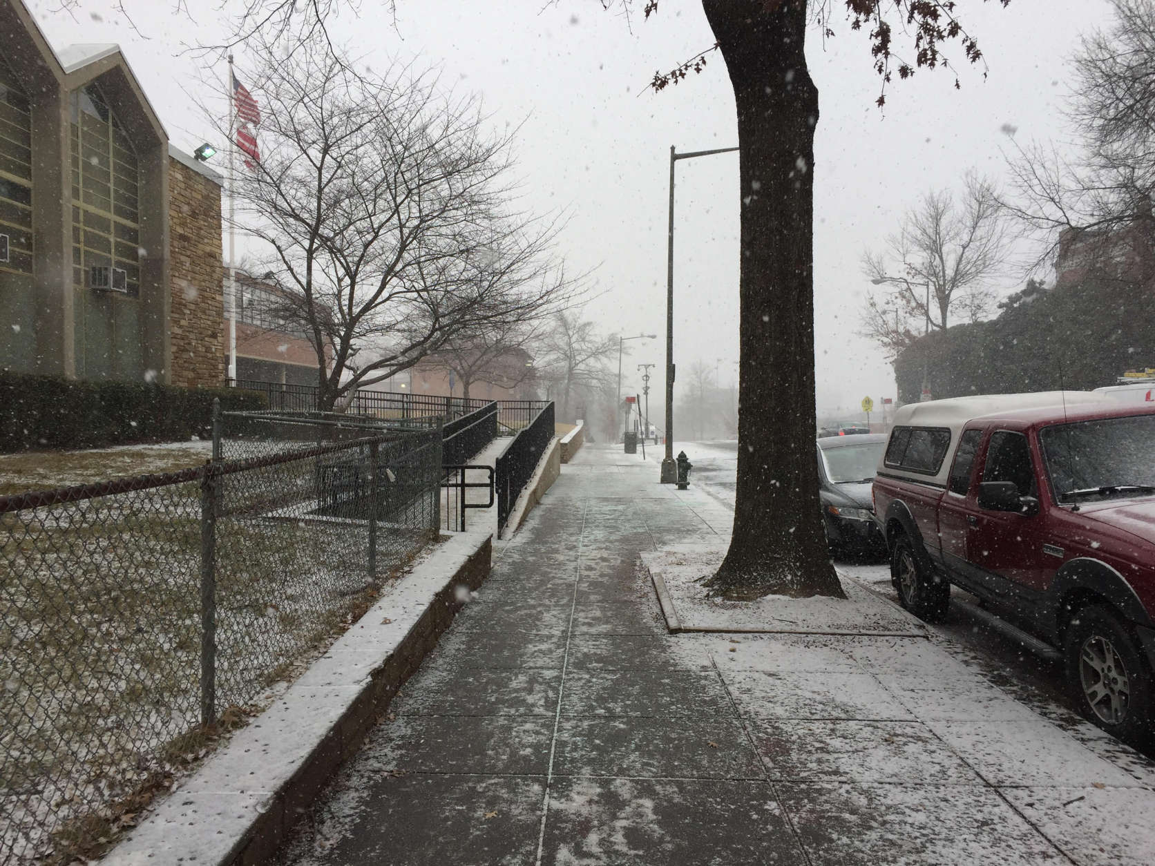 Snow falls, coating the sidewalks Saturday on 11th Street Northwest in D.C. (Courtesy Isaac DeSanto)