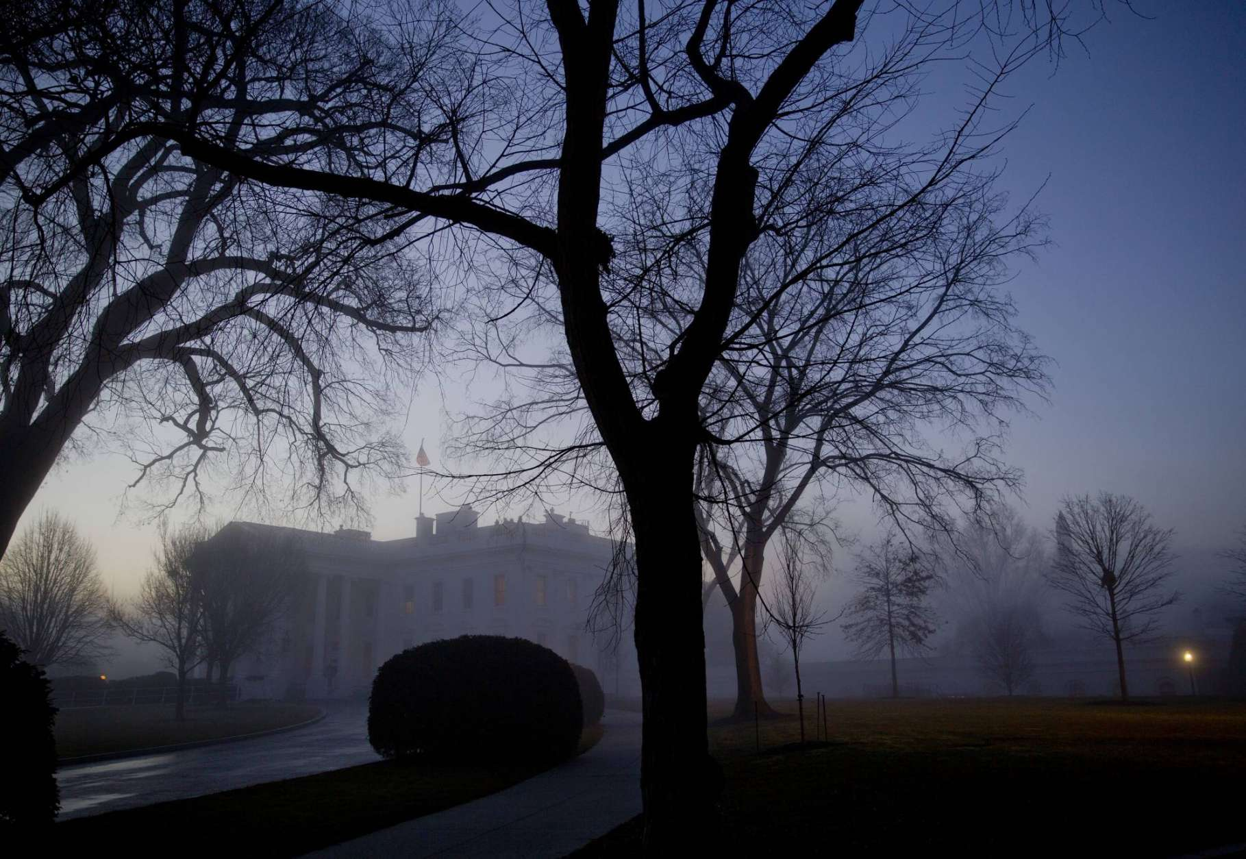 Morning fog is seen at the White House in Washington, Wednesday, Jan. 18, 2017. President Barack Obama is in the final days of his presidency with an 11th hour push to tie up loose ends and put the finishing touches on his legacy before handing the reins to President-elect Donald Trump. (AP Photo/Pablo Martinez Monsivais)