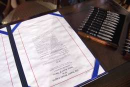 "FILE - In this Dec. 22, 2010, file photo, the ""don't ask, don't tell"" repeal legislation that will allow gays to serve openly in the military sits on a desk at the Interior Department in Washington prior to President Barack Obama signing. Obama took office in 2009 as a self-described ""fierce advocate"" for gay rights, yet for much of his first term drew flak from impatient, skeptical activists who viewed him as too cautious, too politically expedient. They were frustrated that he wouldn't endorse same-sex marriage _ Obama cagily said he was ""evolving"" _ and wanted him to move faster on several other issues. But the pace of Obama's actions steadily accelerated. (AP Photo/Evan Vucci, File)"
