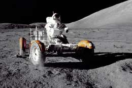 """In this December 1972 photo provided by NASA, Apollo 17 commander Eugene Cernan makes a short checkout of the Lunar Roving Vehicle on the moon. NASA announced that former astronaut Cernan, the last man to walk on the moon, died Monday, Jan. 16, 2017, surrounded by his family. He was 82. (Harrison H. """"Jack"""" Schmitt/NASA via AP)"""