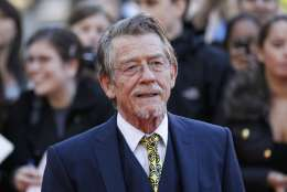 """File - This Sep. 13, 2011, shows British actor and cast member John Hurt arriving for the UK film premiere of """"Tinker Tailor Soldier Spy"""" at the BFI Southbank in London. The great and versatile actor Hurt, who could move audiences to tears in """"The Elephant Man,"""" terrify them in """"Alien,"""" and spoof that very same scene in """"Spaceballs,"""" has died at age 77.  Hurt, who battled pancreatic cancer, passed away Friday, Jan. 27, 2017, in London according to his agent Charles McDonald. (AP Photo/Sang Tan, File)"""