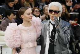 Lily-Rose Depp models with German fashion designer Karl Lagerfeld during Chanel's Haute Couture Spring-Summer 2017 fashion collection prsented in Paris, Tuesday, Jan.24, 2017. (AP Photo/Francois Mori)