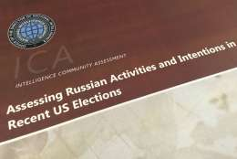A part of the declassified version Intelligence Community Assessment on Russia's efforts to interfere with the U.S. political process is photographed in Washington, Friday, Jan. 6, 2017. Russian President Vladimir Putin ordered a campaign to influence the American presidential election in favor of electing Donald Trump, according to the report issued by U.S. intelligence agencies. The unclassified version was the most detailed public account to date of Russian efforts to interfere with the U.S. political process, with actions that included hacking into the email accounts of the Democratic National Committee and individual Democrats like Hillary Clinton's campaign chairman John Podesta. (AP Photo/Jon Elswick)