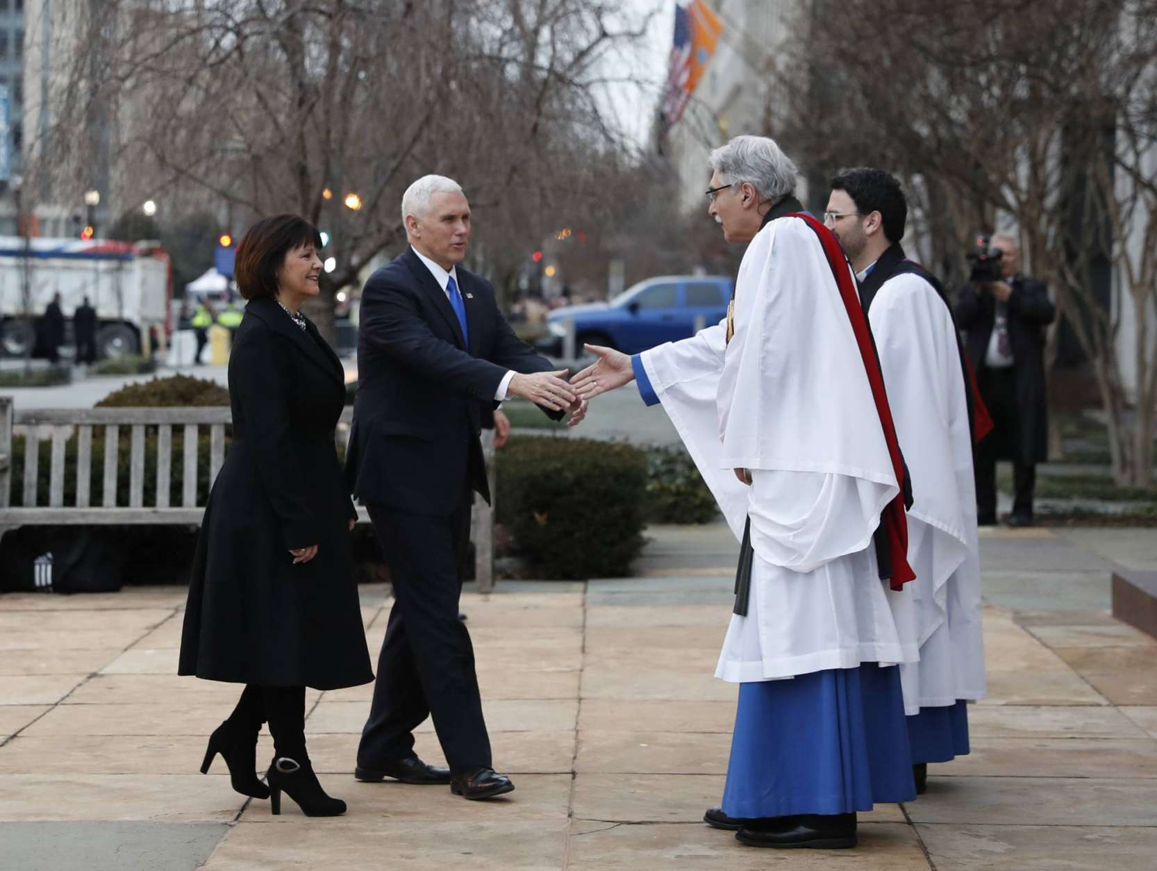 Rev. Luis Leon greets Vice President-elect Mike Pence and his wife Karen as they arrive for a church service at St. John's Episcopal Church across from the White House in Washington, Friday, Jan. 20, 2017, on Donald Trump's inauguration day. (AP Photo/Alex Brandon)