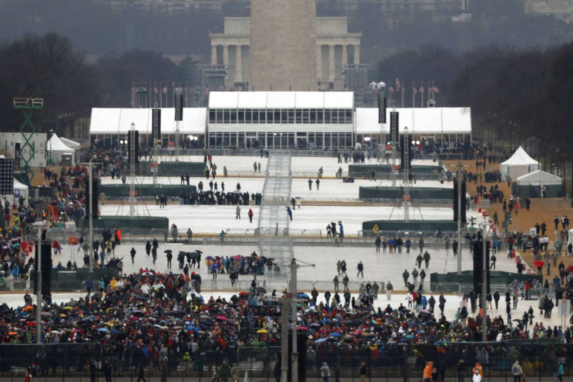 The crowd starts to fill in along the National Mall before the swearing in of Donald Trump as the 45th president of the Untied States during the 58th Presidential Inauguration at the U.S. Capitol in Washington. Friday, Jan. 20, 2017 (AP Photo/Carolyn Kaster)