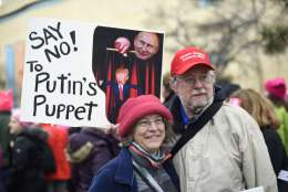 Sandy Cryder, left, and Dan Norum of Baltimore, Md., attend the Women's March on Washington on Independence Ave. on Saturday,  Jan. 21, 2017 on the first full day of Donald Trump's presidency.  Thousands are massing on the National Mall for the Women's March, and they're gathering, too, in spots around the world.  (AP Photo/Sait Serkan Gurbuz)
