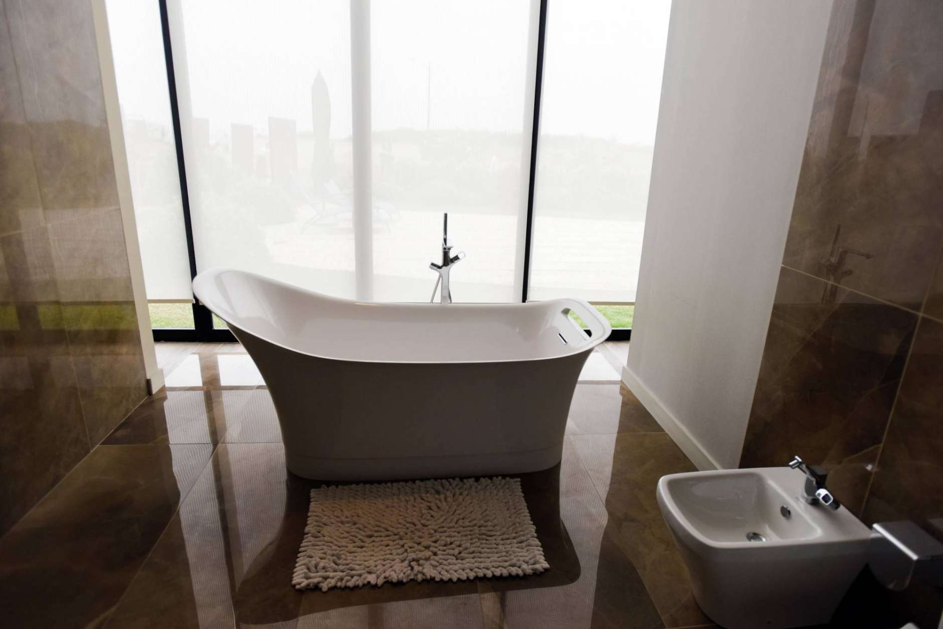 This Jan. 17, 2017 photo shows the showroom bathroom at Trump Tower being built in Punta del Este, Uruguay. The tower will have two indoor heated pools, spa, sauna, Scottish shower, massage room, private theater, private wine cellar and the building's own market. Covered regulation tennis courts will include spectator seating and intelligent climate control. (AP Photo/Matilde Campodonico)