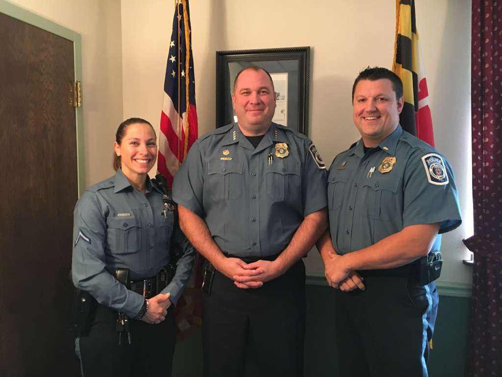"""If we did not have naloxone, our fatal overdose numbers would be double what they are. And they're double what they were last year anyway,"" said Anne Arundel County Police Chief Tim Altomare (center). Officer Gina Chen (left) saved a 19-year-old woman with naloxone in May. Lt. Ryan Frashure is shown on the right. (WTOP/Jamie Forzato)"