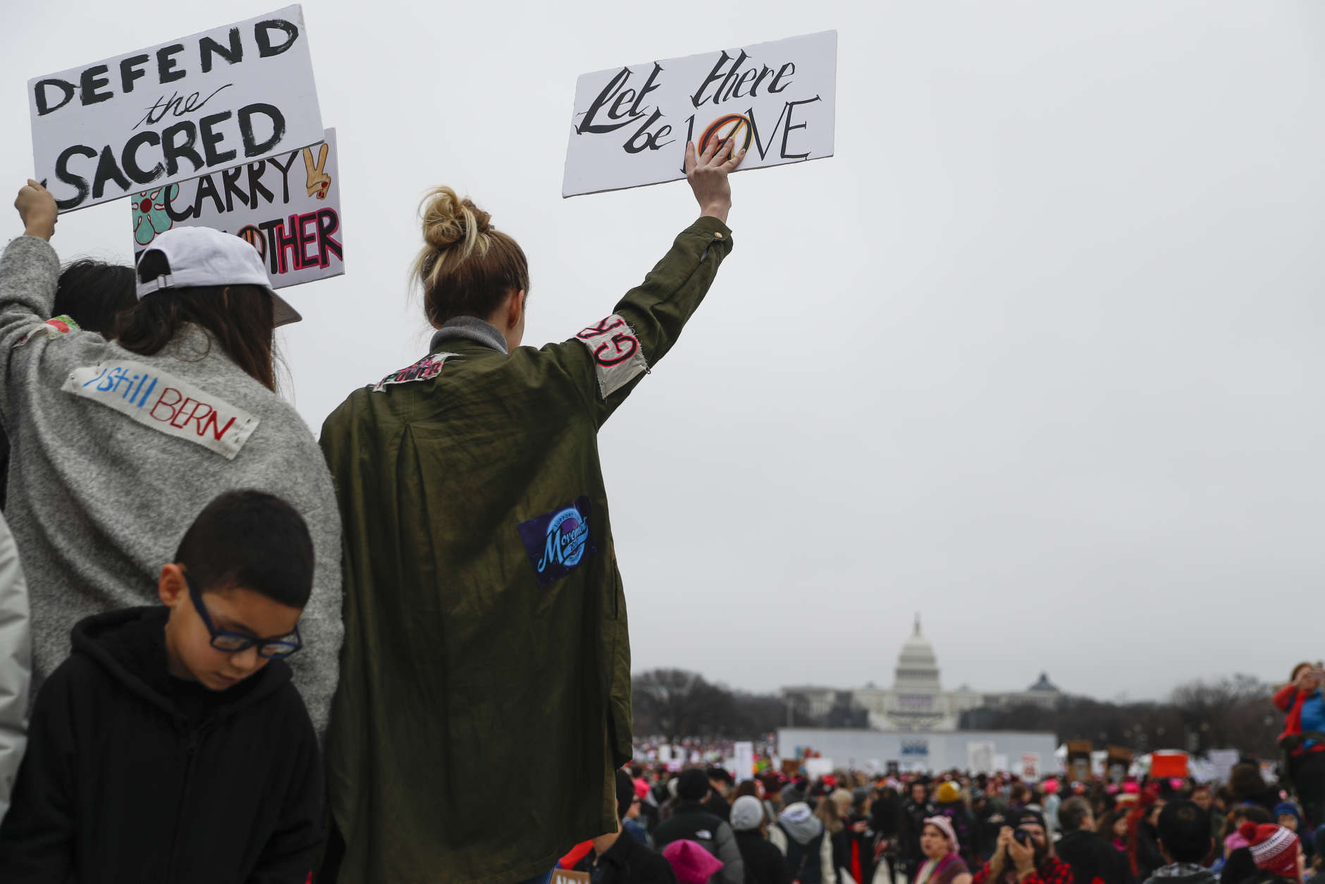 Protesters gather on the National Mall for the Women's March on Washington during the first full day of Donald Trump's presidency, Saturday, Jan. 21, 2017 in Washington.  (AP Photo/John Minchillo)