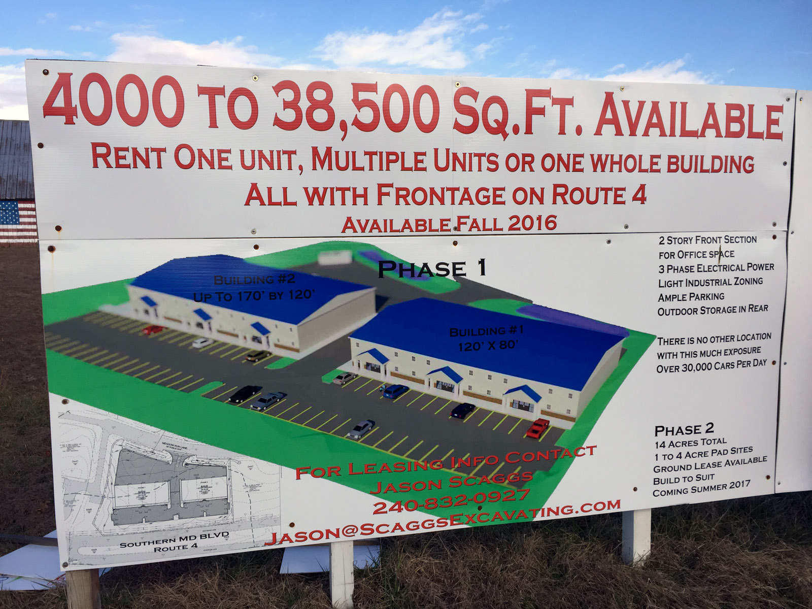 A sign near the barn describes the new development planned for the site. Permits for the light industrial project are expected to come through in the next few months. The current landowner has agreed to allow the barn to be relocated but barn fans say they need $64,000 to cover the cost of the move. (WTOP/Michelle Basch)