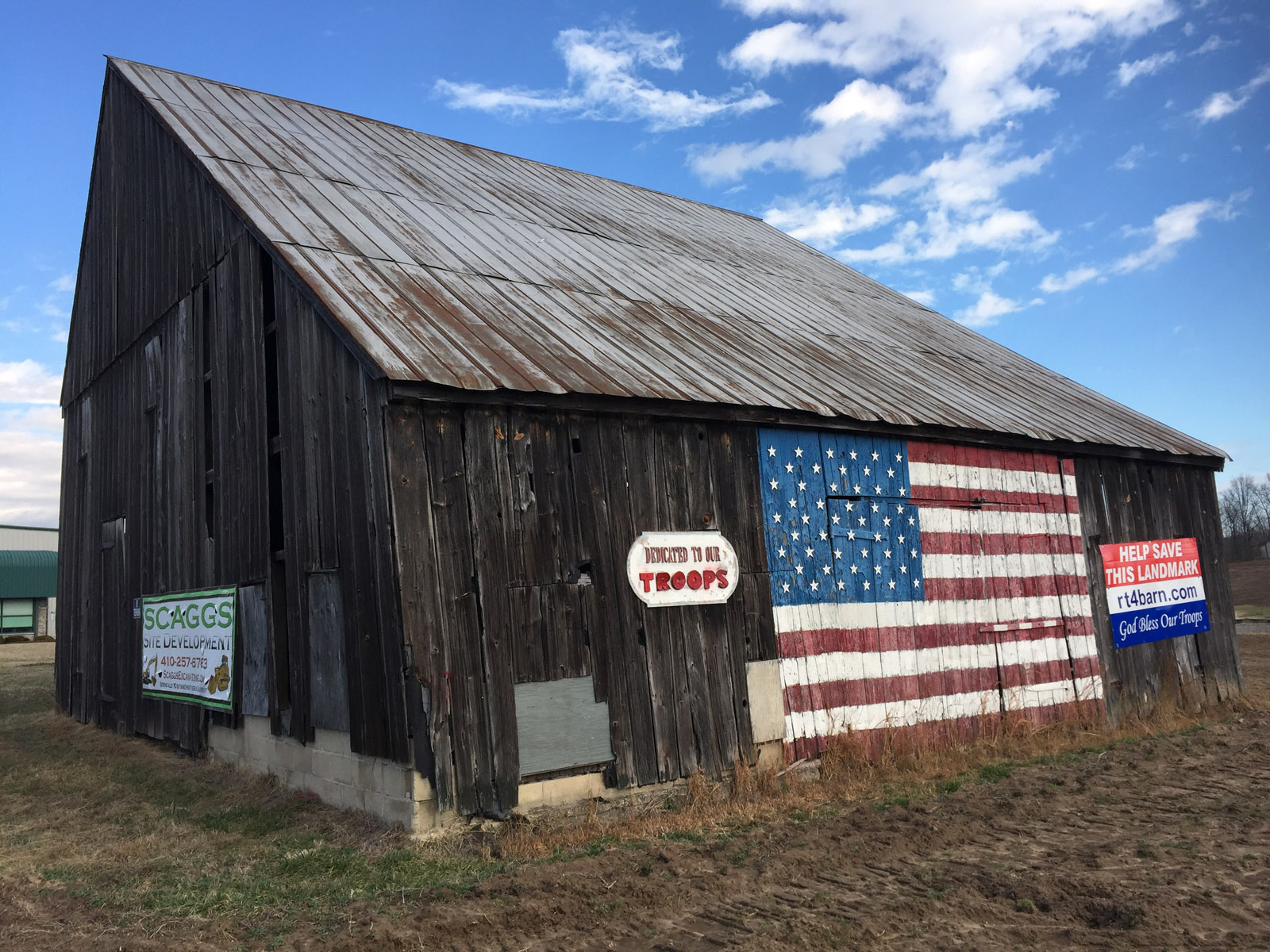"Efforts are underway to preserve Calvert County's ""Flag Barn,"" which sits along Maryland Route 4 in Owings. (WTOP/Michelle Basch)"