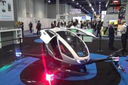 A startup from France called REVA2, which is designing a fleet of driverless vehicles that can be accessed by smartphone, tablet or PC, is also experimenting with transport that takes to the skies. (WTOP/Kenny Fried)