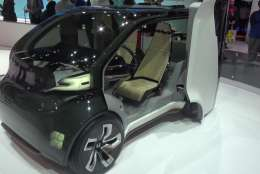 Honda has incorporated both concepts into NeuV, a self-driving, two-seat commuter car for urban environments powered by an Emotion Engine that learns by detecting the emotions behind the driver's judgments and then, based on the driver's past decisions, makes new choices and recommendations. (WTOP/Kenny Fried)