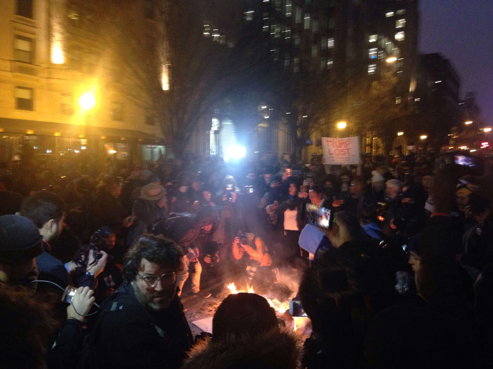 Inauguration protests continue after sun sets in D.C. on Friday, Jan. 20, 2017. (WTOP/Megan Cloherty)