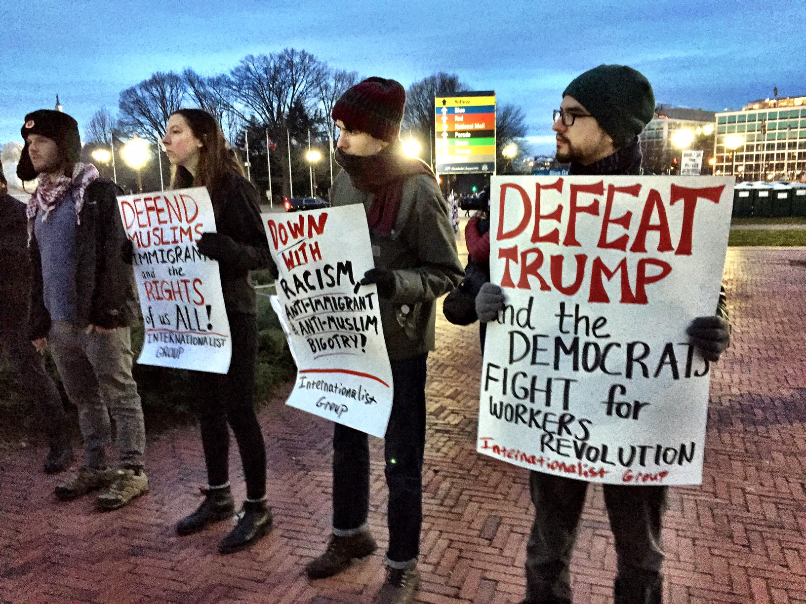 J20Resist protesters stand with signs outside of outside of Union Station early Inauguration Day. (Courtesy Cami McCormick)