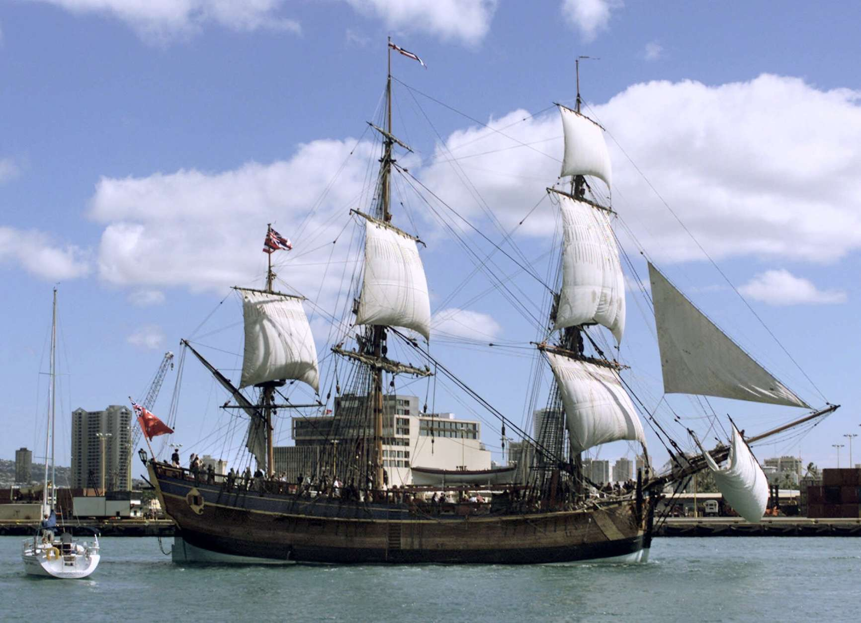 "A replica of Captain James Cook's ""Endeavour"" leaves Honolulu Harbor Monday, Nov.15, 1999, for Nawiliwili Harbor on Kauai as part of its four-year around-the-world cruise. Cook sailed the ""Endeavour"" around the world in a famous 1768-71 exploration. He later arrived in Hawaii in 1778 aboard the ""Resolution"" accompanied by the ""Discovery"". The replica ship, built in Australia, carries 18 professional seamen and 34 volunteers. (AP Photo/Ronen Zilberman)"
