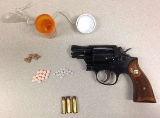 Anne Arundel County Police recovered 38 various OxyContin pills and a stolen .38 caliber Smith & Wesson revolver on December 9, 2016 after an altercation at a Denny's Restaurant in Glen Burnie. The suspect was charged with attempted robbery and assault, along with other drug, weapons and theft charges. (Courtesy Anne Arundel County Police)
