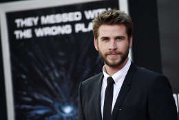 "Liam Hemsworth, a cast member in ""Independence Day: Resurgence,"" poses at the premiere of the film at the TCL Chinese Theatre on Monday, June 20, 2016, in Los Angeles. (Photo by Chris Pizzello/Invision/AP)"