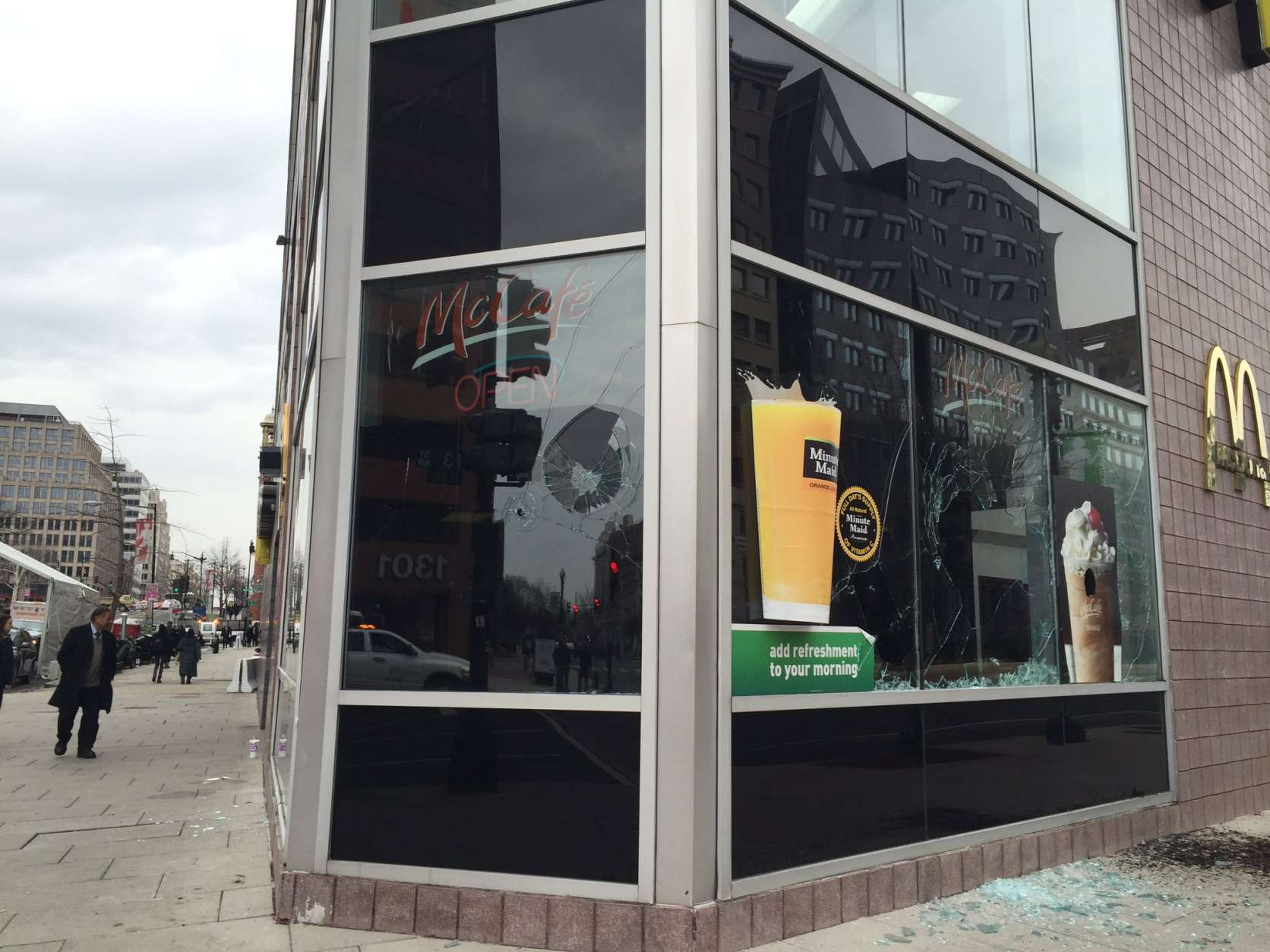 Protests escalate, and a McDonald's on the corner of New York Avenue and 13th Street NW suffers damage. (WTOP/Dennis Foley)