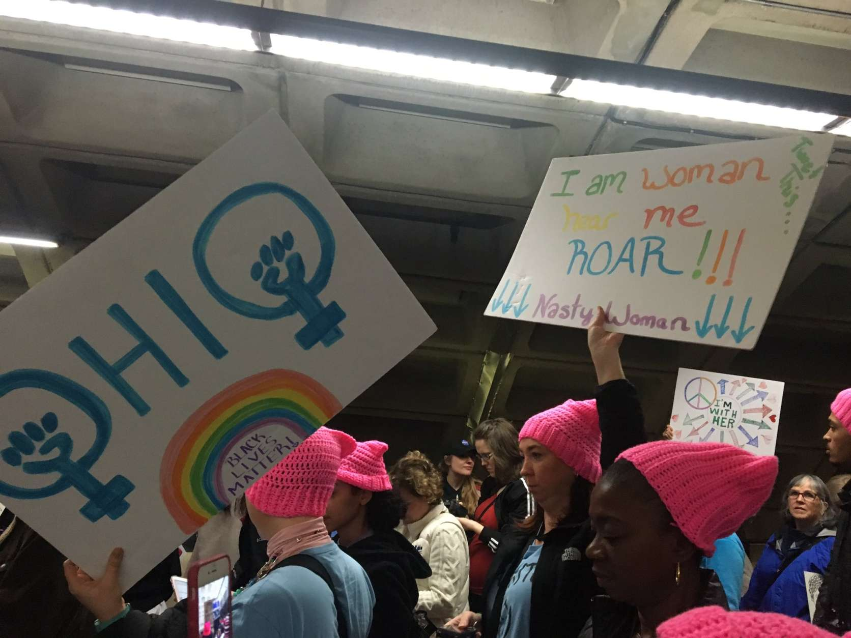 "Crowds of people fill L'Enfant Plaza Metro station, chanting ""Fired up, ready to go"" as they head toward the Women's March on Washington Saturday, Jan. 21, 2017. (WTOP/Max Smith)"