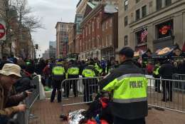"""Anti-Trump protesters at 10th and E Street NW shout """"Shut it down!"""" while """"shaming"""" attendees, says WTOP's Dennis Foley. (WTOP/Dennis Foley)"""