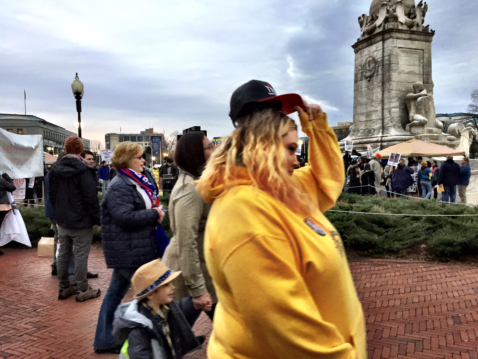 Trump supporters file past protesters underneath a cloudy sky the morning of Inauguration Day. (Courtesy Cami McCormick)